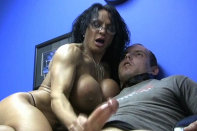 Muscled cock stroking 55. Wunder Woman wants to do more with her greatest fan. She shoves her big muscled breast in his face, pulls out his heavy cock, oils it up, and strokes it with her fit grip.